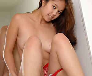 Amateur Asian babe slips off panties to expose phat ass and spread pussy