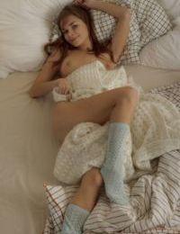 Sweet teen girl Justine Hayes makes her nude modeling debut in a pair of socks