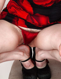 Curvy mature lassie with saggy jugs undressing and showcasing her hairy cooter