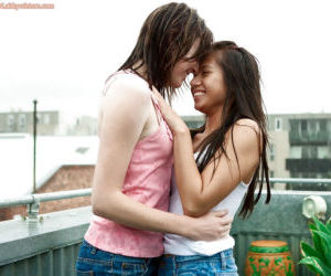 Young amateur girls Larissa M and Silvie share tongue kiss outdoors