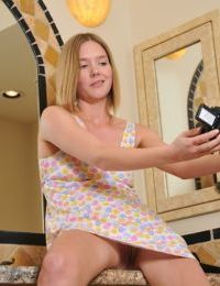 Amateur teen Star gets naked in the bath and films herself with smile