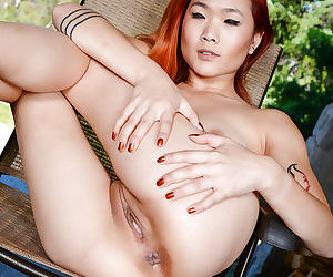 Malaysian first timer Lea Hart showing off spread ass and pussy outdoors