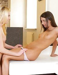 Teen lesbians Angel and Angie finger and trib each others young pussy