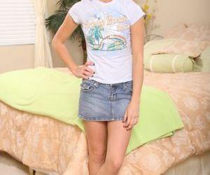 Brunette babe Stephanie Sage is undressing her pink underwear