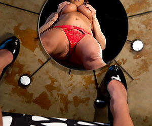 Erotic MILF Nikki Sims in sexy underwear strips to flaunt her massive tits