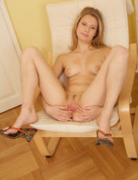 Lusty blonde amateur undressing and teasing her slit with her fingers