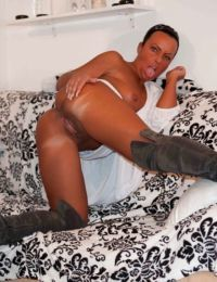Mature Candy Cox flaunting her goodies while wearing designer boots