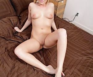 Young blonde girl shows off her pink pussy in her nude modeling debut