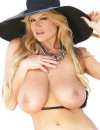 Mature blondie Kelly Madison shows off in a perfect black bikini
