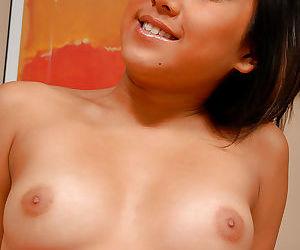 Asian first timer Tinah showing off nice natural boobs in close ups