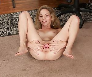 Petite solo girl Angel Smalls stretches her snatch wide open after disrobing