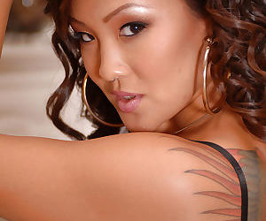 Petite Asian amateur Jandi showing off tattoos and small breasts
