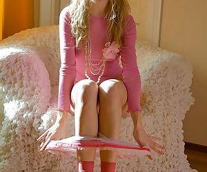 Frisky teenie in pink socks taking off her panties and fingering her slit