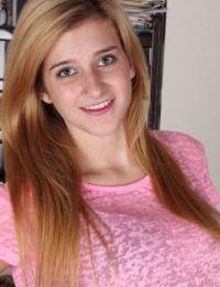 Blonde teener Karma Jones posing for close up topless solo girl shoot