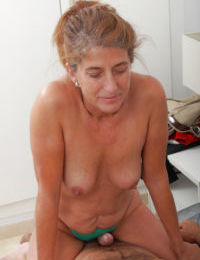 Horny grandmother Meg taking cumshot on granny boobs after riding cock