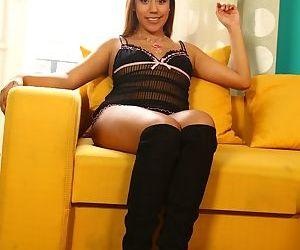 Cute amateur girl slips off her sheer lingerie prior to finger fucking herself