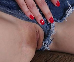 Petite redhead Nancy Reid baring nice young boobs and parting pussy