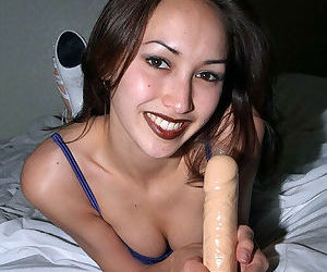Petite Asian amateur Tina playing with large dildo on bed in high heels