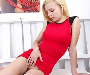 Sexy short-haired blonde Sophia Kitten shows off her cute-looking puss