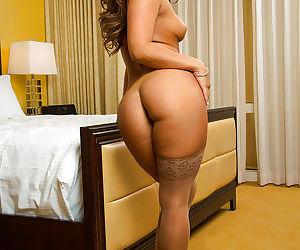 Sexy babe Eva Lovia striking hot solo girl poses in pantyhose and underwear