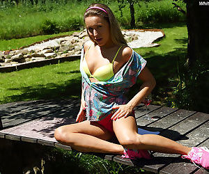 Young amateur girl Whitney Conroy baring nice small breasts outdoors