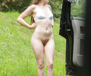 Naked female Tiffany covering her small tits and hairy bush with fresh clothes