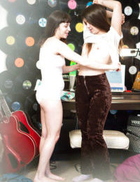 Sexy hairy lesbian teen amateurs Gala and Lulu putting their clothes on