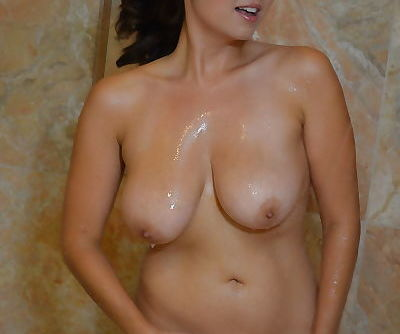 Hot brunette with big natural tits Mai Ly taking a shower