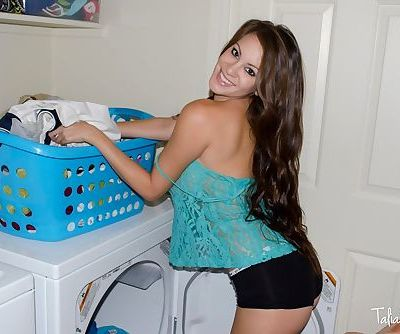 Amateur model Talia Shepard uncovers her knockers while doing laundry