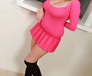 Busty young blonde Tegan Brady poses in knee socks and a pink tight dress