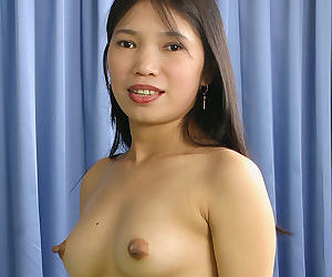 Amateur Asian babe with hairy pussy Diep undresses her tight skirt