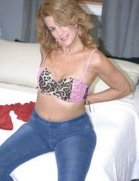 Mature amateur Danielle Brooks baring tiny tits and ass before masturbating