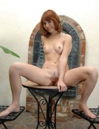 Redhead amateur strips down to expose her fanny and pussy in close up