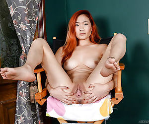 Busty Asian amateur Lea Hart spreading shaved solo girl pussy