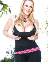 Mature slut Kelly Madison shows off her big tits outdoor in a lingerie