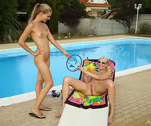 Scrawny young Cayenne pins her pussy wide by the pool for kinky insertions