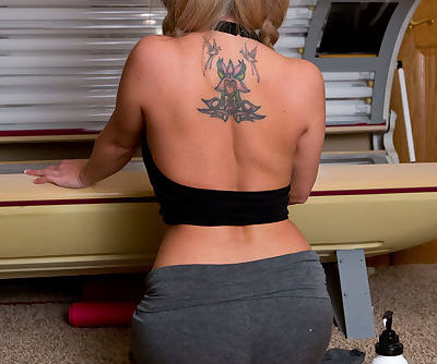 Blond amateur Nikki Sims teases in lingerie before climbing into tanning booth