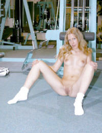 Blonde teen with perky tits Zuzana undressing at the gym