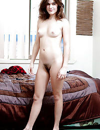 Hairy first timer Arienne showing off small breasts and pussy