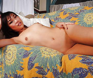 Tiny tits Asian babe Minnie is revealing her tattoos in close up