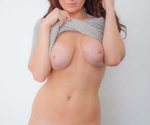 Super sexy redhead Emmy Sinclair posing naked in socks to flaunt her hot wares