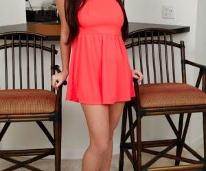Big titted teen girl Karlee Grey bent over for upskirt view of panties