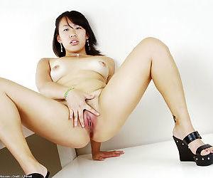 Amateur Asian Mia spreading hairy vagina after upskirt flash
