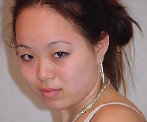 Horny Asian model China masturbates her tight hole using her fingers