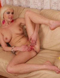 Bosomy blonde amateur stripping down and fingering her shaved cunt