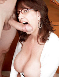 Glasses clad amateur Cassie Cougar baring big mature tits before giving bj