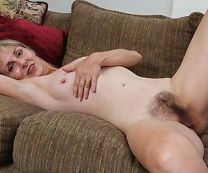 Beauty mature blonde Sophie is posing and playing with pussy