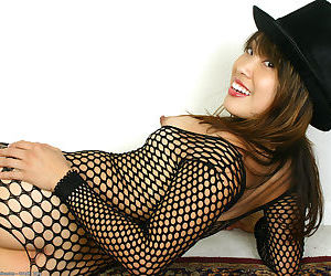 Asian amateur spreads butt cheeks to bare bald twat in fishnet bodystocking