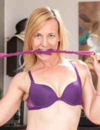 Mature blonde lady Cody Hunter removes her lingerie and high heeled shoes