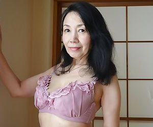 Tsuyako Miyataka spreads her mature hairy Asian pussy after undressing